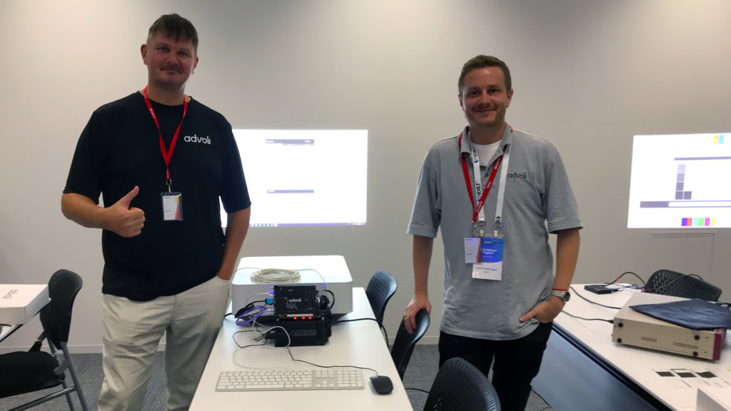 Clas and Paul of advoli posing with TC1 Extreme and Sony Projector using controls over ethernet